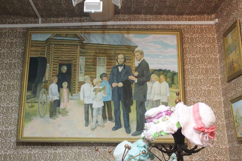 На картине Илья Николаевич Ульянов с первым учителем училища.